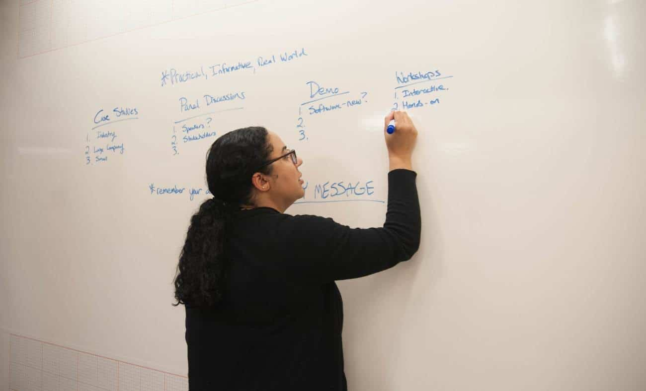 woman writing on a whiteboard